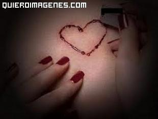 Tatuaje de un corazón con una cuchilla imágenes